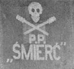 A badge on one of 'Smierc' wagons in 1920